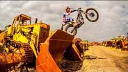 Moto Trials car chase through a scrapyard