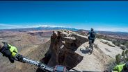 Riding the edge of a 400ft Moab cliff